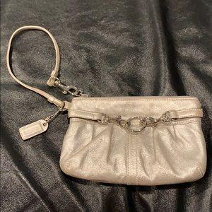 AUTHENTIC silver Coach wristlet